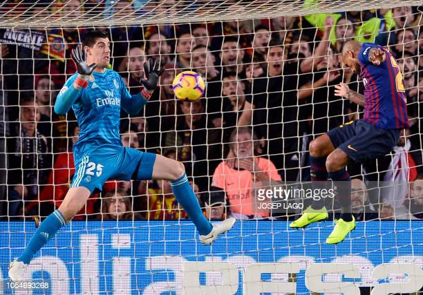 Barcelona's Chilean midfielder Arturo Vidal scores Barcelona's fifth goal during the Spanish league football match between FC Barcelona and Real...