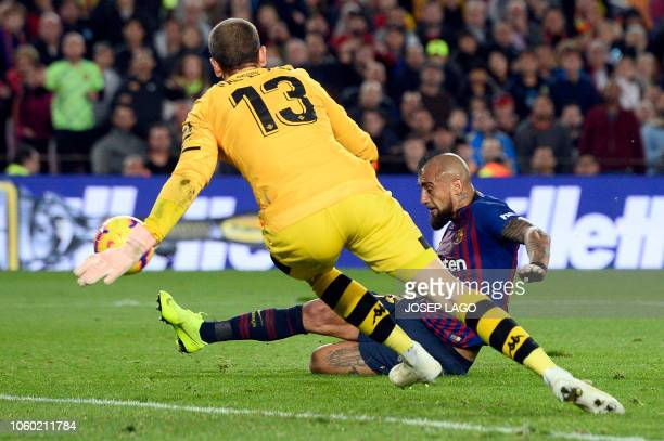 Barcelona's Chilean midfielder Arturo Vidal scores his team's second goal during the Spanish league football match between FC Barcelona and Real...