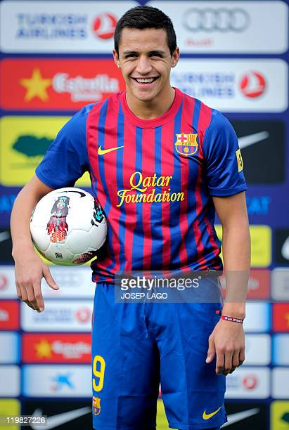Barcelona's Chilean new player Alexis Sanchez is pictured during his official presentation after signing a new contract with the Catalan club on July...