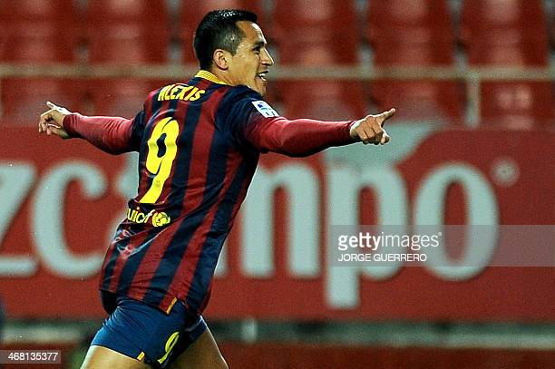 Barcelona's Chiliean forward Alexis Sanchez celebrates after scoring during the Spanish league football match Sevilla vs FC Barcelona at the Ramon...