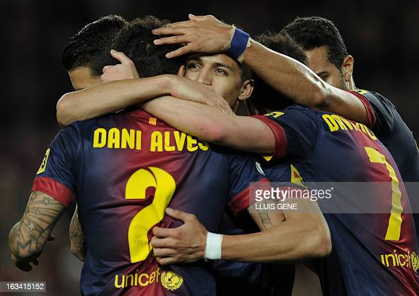 Barcelona's Chiliean forward Alexis Sanchez celebrates with his teammates after scoring during the Spanish league football match FC Barcelona vs RC...