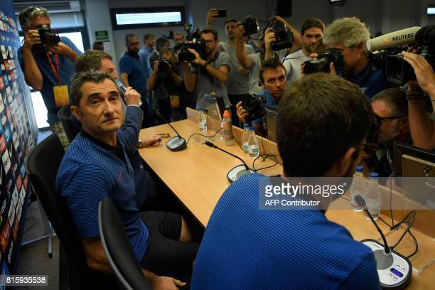 Barcelona's coach Ernesto Valverde poses before his first press conference at the Sports Center FC Barcelona Joan Gamper in Sant Joan Despi near...