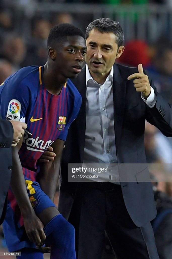 Barcelona's coach Ernesto Valverde (R) talks to Barcelona's French forward Ousmane Dembele during the Spanish Liga football match Barcelona vs Espanyol at the Camp Nou stadium in Barcelona on September 9, 2017. /