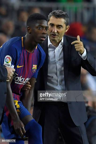 Barcelona's coach Ernesto Valverde talks to Barcelona's French forward Ousmane Dembele during the Spanish Liga football match Barcelona vs Espanyol...