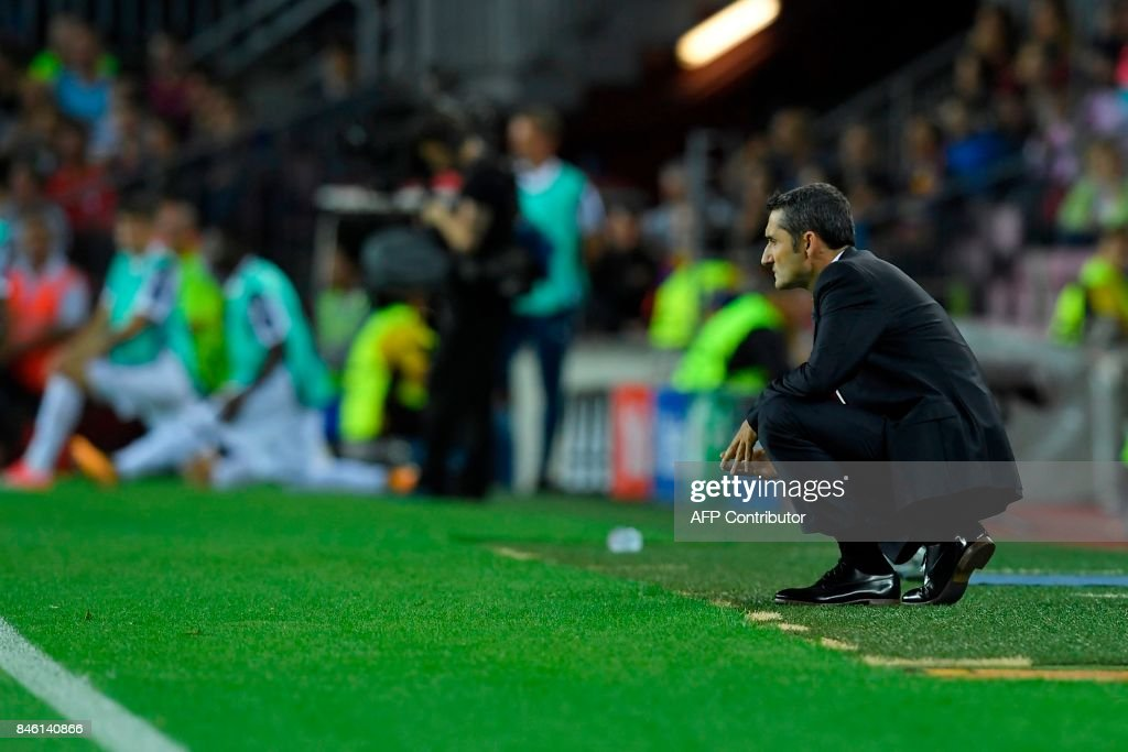 Barcelona's coach from Spain Ernesto Valverde looks on from the sideline during the UEFA Champions League Group D football match FC Barcelona vs Juventus at the Camp Nou stadium in Barcelona on September 12, 2017. /
