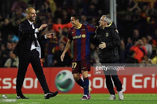 Barcelona's coach Josep Guardiola and Barcelona's forward Pedro Rodriguez celebrate after winning the Champions League semi-final second leg football...