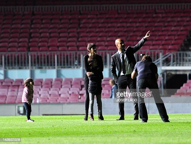 Barcelona's coach Josep Guardiola and his family at the end the Spanish League football match FC Barcelona vs RCD Espanyol at the Camp Nou stadium in...