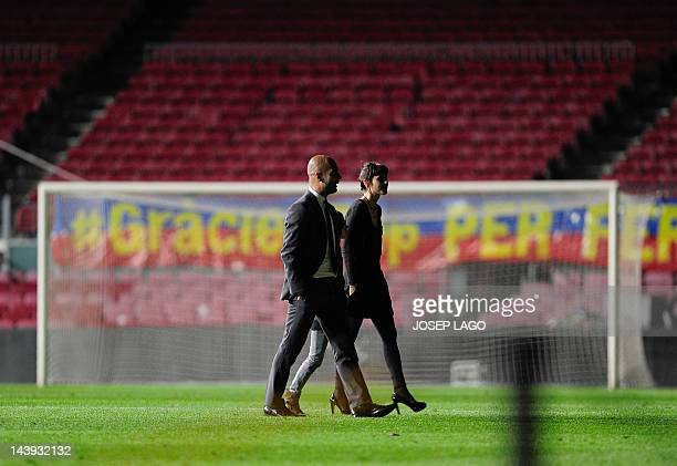 Barcelona's coach Josep Guardiola and his family look around the stadium at the end the Spanish League football match FC Barcelona vs RCD Espanyol at...