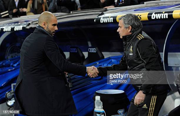 Barcelona's coach Josep Guardiola and Real Madrid's coach Jose Mourinho shake hand before the Spanish Cup 'El clasico' football match Real Madrid vs...