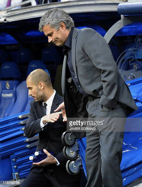 Barcelona's coach Josep Guardiola and Real Madrid's Portuguese coach Jose Mourinho shake hands before the Champions League semifinal first leg...
