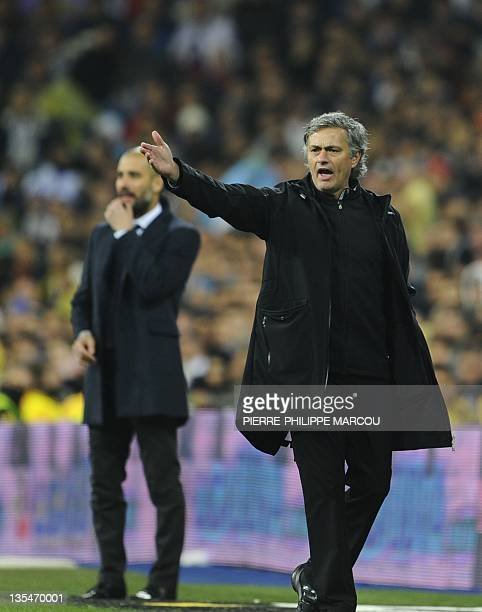 Barcelona's coach Josep Guardiola and Real Madrid's Portuguese coach Jose Mourinho attend the 'El clasico' Spanish League football match Real Madrid...