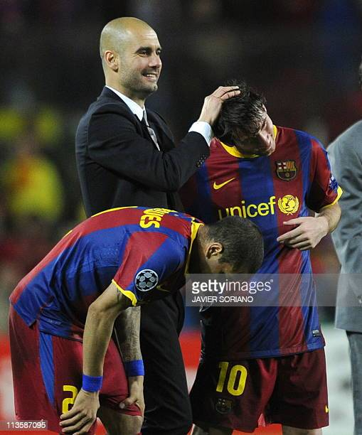 Barcelona's coach Josep Guardiola celebrates with Barcelona's Argentinian forward Lionel Messi and Barcelona's Brazilian defender Dani Alves after...