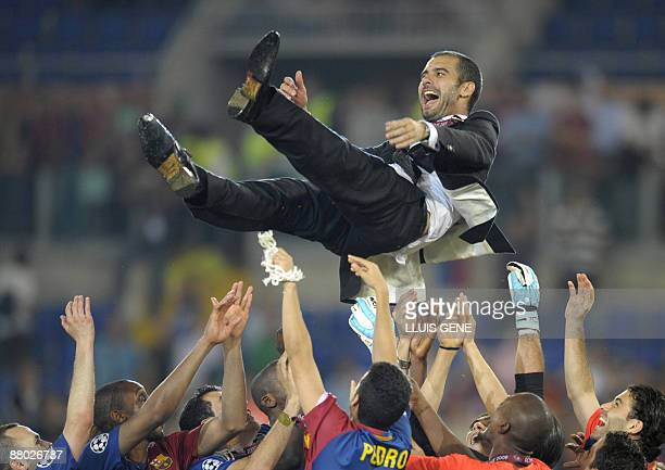 Barcelona´s coach Josep Guardiola celebrates with players after the trophy ceremony of the final of the UEFA football Champions League on May 27 2009...