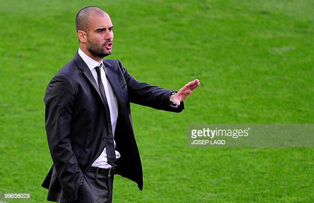 Barcelona's coach Josep Guardiola gestures during Spanish League football match against Valladolid at the Camp Nou Stadium in Barcelona, on May 16,...