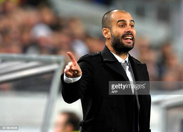 Barcelona's coach Josep Guardiola gestures during the VfB Stuttgart vs FC Barcelona UEFA Champions League football round of 16 match in the southern...