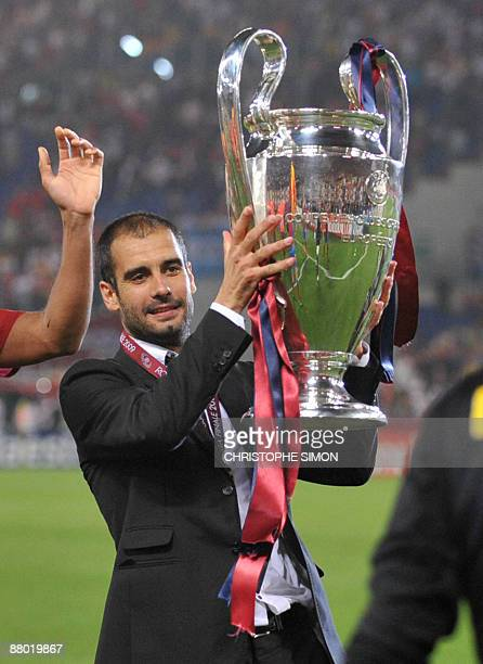 Barcelona´s coach Josep Guardiola holds the Champions League Cup after the trophy ceremony on May 27 2009 at the Olympic Stadium in Rome Barcelona...
