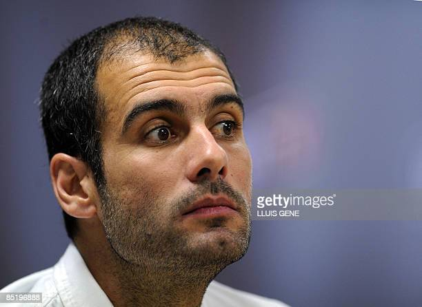 FC Barcelona's coach Josep Guardiola listens during a press conference on February 3 at the Sports Center FC Bacelona Joan Gamper near Barcelona on...