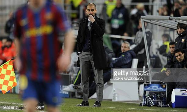 Barcelona's coach Josep Guardiola reacts during the VfB Stuttgart vs FC Barcelona UEFA Champions League football round of 16 match in the southern...