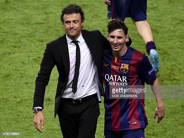 Barcelona's coach Luis Enrique and Barcelona's Argentinian forward Lionel Messi celebrate after winning the UEFA Champions League Final football...