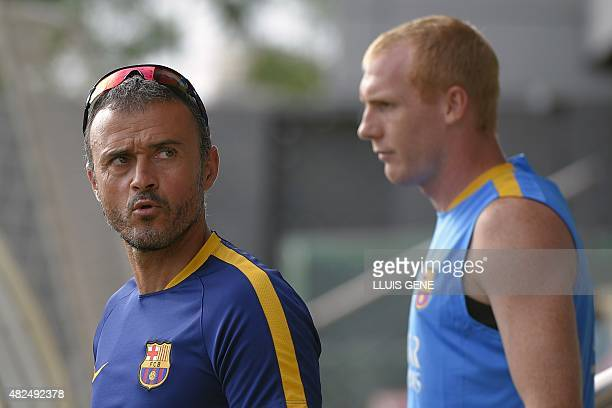 Barcelona's coach Luis Enrique and Barcelona's French defender Jeremy Mathieu arrive to a training session at the Sports Center FC Barcelona Joan...