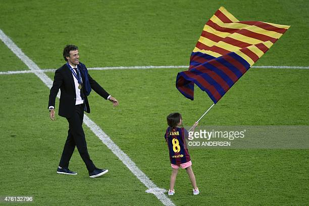 Barcelona's coach Luis Enrique and his daugther Xana celebrate after the UEFA Champions League Final football match between Juventus and FC Barcelona...