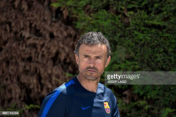 Barcelona's coach Luis Enrique arrives for a press conference following a training session at the Sports Center FC Barcelona Joan Gamper in Sant Joan...
