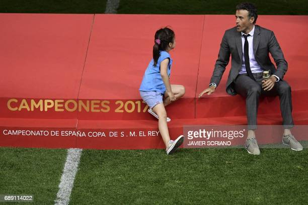 Barcelona's coach Luis Enrique chats with his daughter after Barcelona won the Spanish Copa del Rey final football match FC Barcelona vs Deportivo...