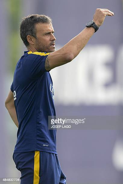 Barcelona's coach Luis Enrique gestures during a training session at the Sports Center FC Barcelona Joan Gamper in Sant Joan Despi, near Barcelona on...