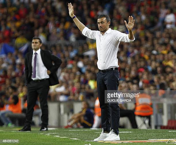 Barcelona's coach Luis Enrique gives instructions to his players next to Athletic Bilbao's coach Ernesto Valverde during the Spanish Supercup...