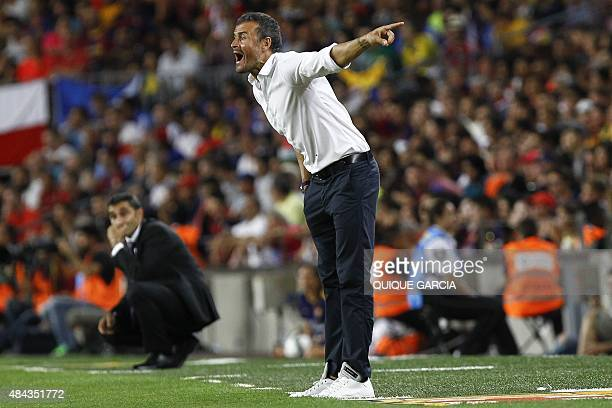 Barcelona's coach Luis Enrique gives instructions to his players next to Athletic Bilbao's coach from Spain Ernesto Valverde during the Spanish...