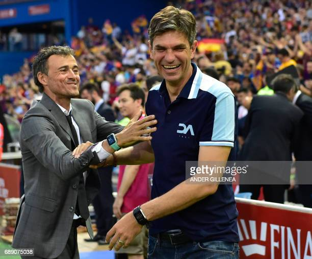 Barcelona's coach Luis Enrique greets Deportivo Alaves' Argentinian coach Mauricio Pellegrino before the Spanish Copa del Rey final football match FC...
