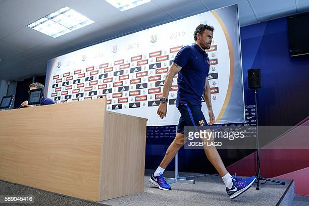 Barcelona's coach Luis Enrique leaves after a press conference following a training session at the Sports Center FC Barcelona Joan Gamper in Sant...