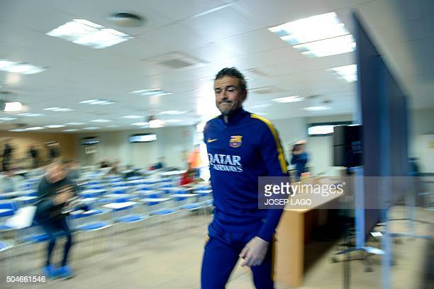 Barcelona's coach Luis Enrique leaves after giving a press conference one day after being awarded the 2015 FIFA World Coach of the Year, at the...