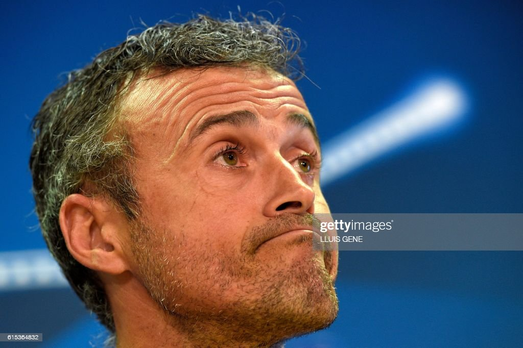 Barcelona's coach Luis Enrique listens to a journalist during a press conference at the Sports Center FC Barcelona Joan Gamper in Sant Joan Despi, near Barcelona on October 18, 2016, on the eve of the UEFA Champions League football match FC Barcelona vs Manchester City. / AFP / LLUIS