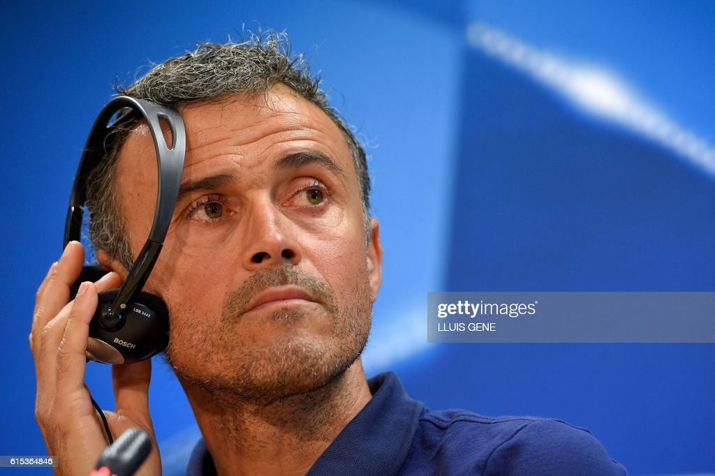 Barcelona's coach Luis Enrique listens to the translation of a journalist's question during a press conference at the Sports Center FC Barcelona Joan Gamper in Sant Joan Despi, near Barcelona on October 18, 2016, on the eve of the UEFA Champions League football match FC Barcelona vs Manchester City. / AFP / LLUIS