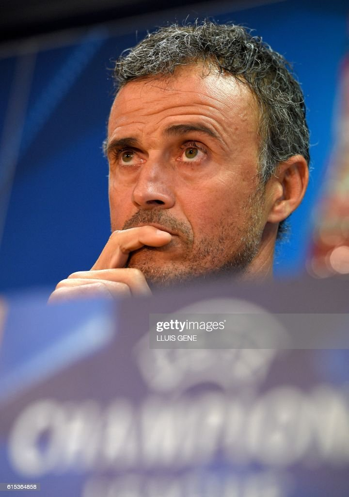 Barcelona's coach Luis Enrique looks on during a press conference at the Sports Center FC Barcelona Joan Gamper in Sant Joan Despi, near Barcelona on October 18, 2016, on the eve of the UEFA Champions League football match FC Barcelona vs Manchester City. / AFP / LLUIS