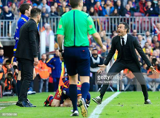 Barcelona's coach Luis Enrique shouts after a fault was committed on Barcelona's Argentinian forward Lionel Messi during the Spanish league football...