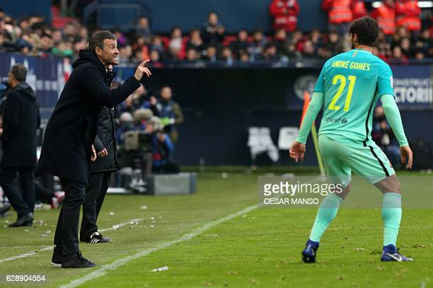Barcelona's coach Luis Enrique speak with Barcelona's Portuguese midfielder Andre Gomes during the Spanish league football match CA Osasuna vs FC...