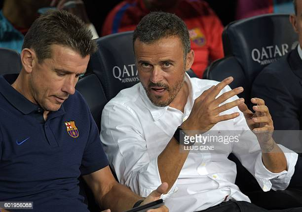 Barcelona's coach Luis Enrique talks with Barcelona's goalkeepers' coach Juan Carlos Unzue before the Spanish league football match FC Barcelona vs...