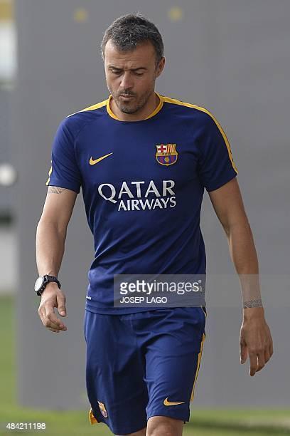 Barcelona's coach Luis Enrique walks during a training session at the Sports Center FC Barcelona Joan Gamper in Sant Joan Despi, near Barcelona on...