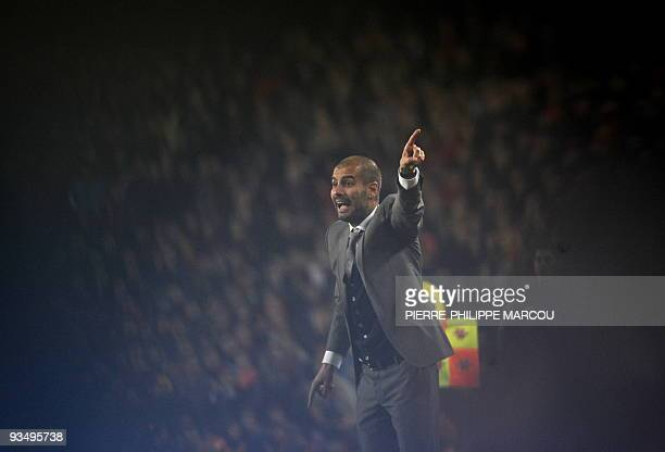 Barcelona's coach Pep Guardiola gestures as they play against Real Madrid during their Spanish League football match between Barcelona and Real...
