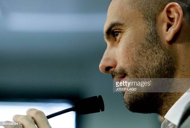 Barcelona's coach Pep Guardiola gestures during a press conference after a training session at Ciutat Esportiva Joan Gamper near Barcelona on...