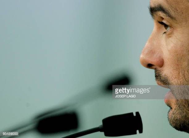 Barcelona's coach Pep Guardiola gives a press conference after a training session at Ciutat Esportiva Joan Gamper near Barcelona on November 28 a day...