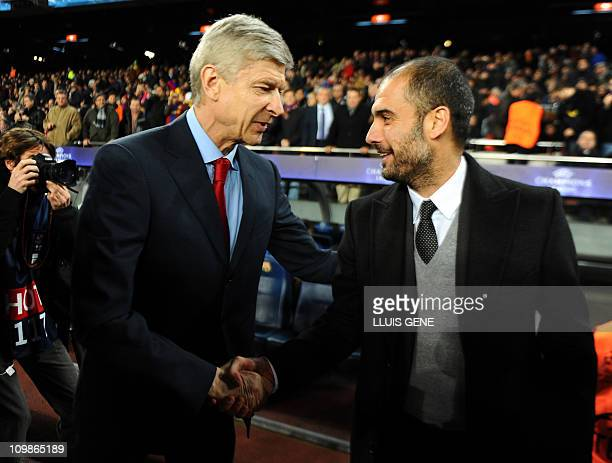 Barcelona's coach Pep Guardiola welcomes Arsenal's French coach Arsne Wenger before the Champions League round of 16 second leg football match FC...