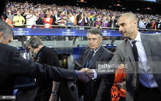 Barcelona´s coach Pep Guardiola welcomes Inter Milan coach Portuguese Jose Mourinho before the UEFA Champions League semifinal second leg football...