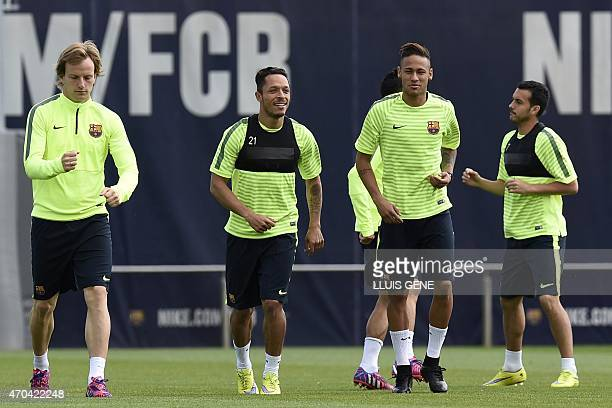 Barcelona's Croatian midfielder Ivan Rakitic Barcelona's Brazilian defender Adriano Barcelona's Brazilian forward Neymar da Silva Santos Junior and...
