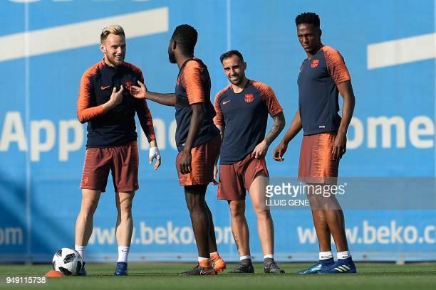 Barcelona's Croatian midfielder Ivan Rakitic Barcelona's French defender Samuel Umtiti Barcelona's forward Paco Alcacer and Barcelona's midfielder...