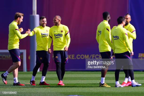 Barcelona's Croatian midfielder Ivan Rakitic, Barcelona's Spanish defender Jordi Alba and Barcelona's Danish forward Martin Braithwaite joke during a...