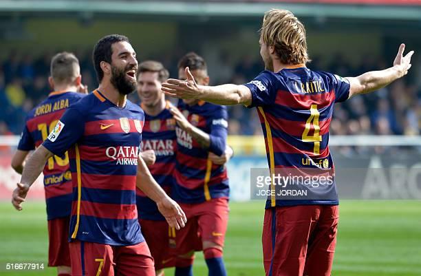 Barcelona's Croatian midfielder Ivan Rakitic celebrates a goal with Barcelona's forward Arda during the Spanish league football match Villarreal CF...
