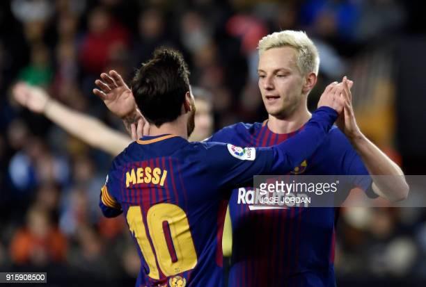 Barcelona's Croatian midfielder Ivan Rakitic celebrates a goal with Barcelona's Argentinian forward Lionel Messi during the Spanish 'Copa del Rey'...